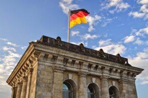 A view of a German flag atop the Brandenburg Gate