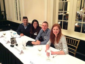 Four TAM alums sit at a panel