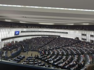 A view of the inside of the European Parliament's main chamber, with seats arrayed in concentric rows